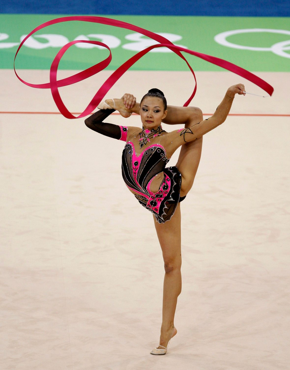Aliya Yussupova of Kazakhstan performs with the ribbon during the individual all-around final of the rhythmic gymnastics competition at the Beijing 2008 Olympic Games